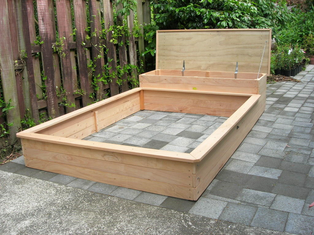 Sandpit with box seat